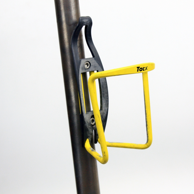 Black and Yellow Spécialités T.A. bottle cage with screw